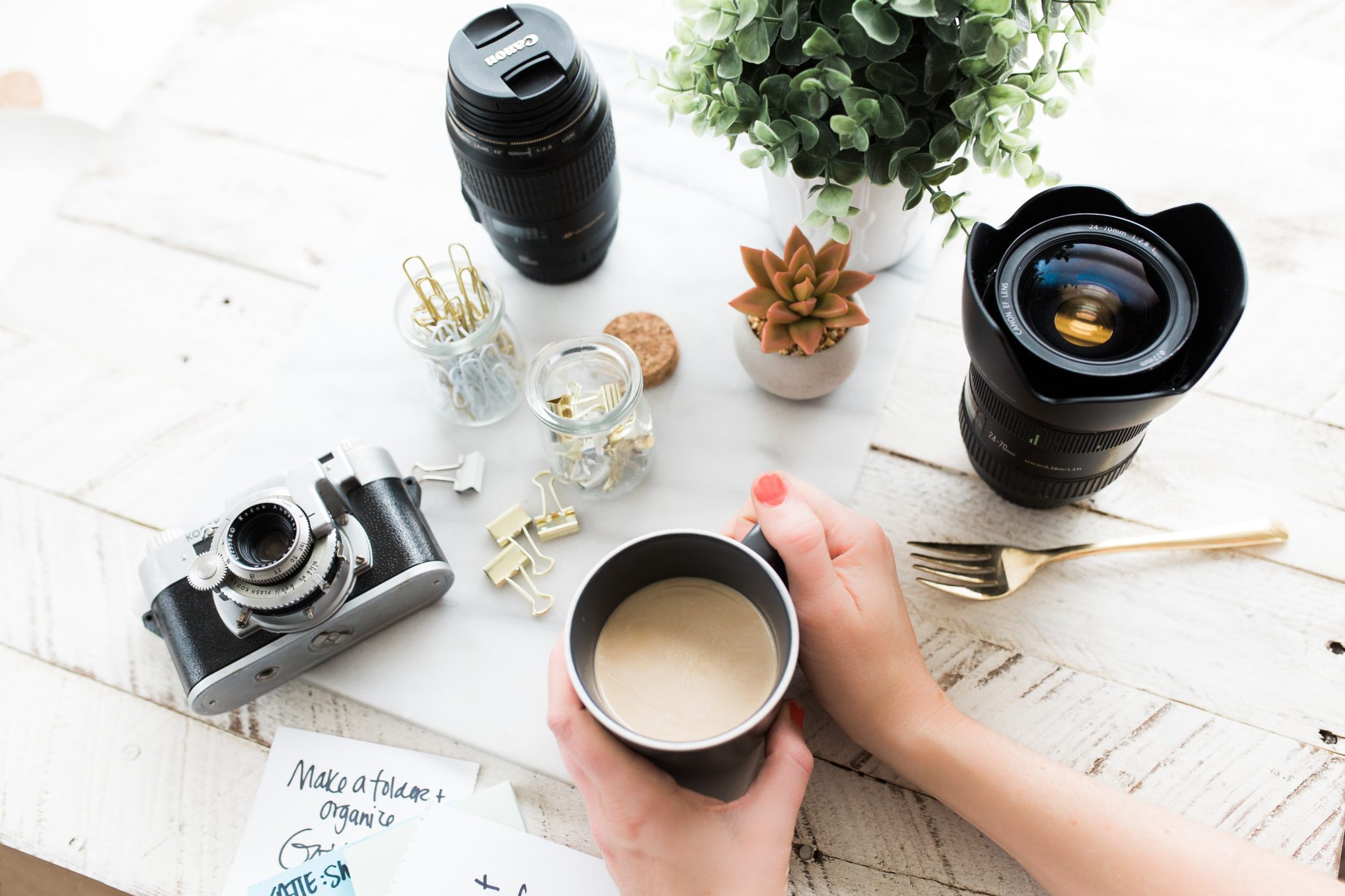 Cameras and coffee flatlay | © Brooke Lark/Unsplash
